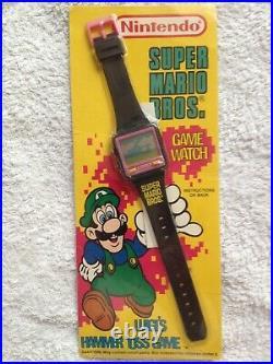 Rare vintage LCD Wrist Watch Game Super Mario Bros. Luigi's Hammer Toss Nintendo