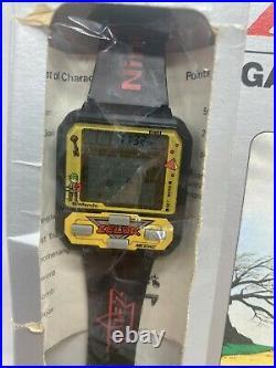 Vintage Nelsonic Nintendo Black LEGEND OF ZELDA Game Watch with Box, instructions