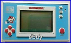 Vtg 1988 nintendo SUPER MARIO BROS. Handheld video game YM-105 game & watch